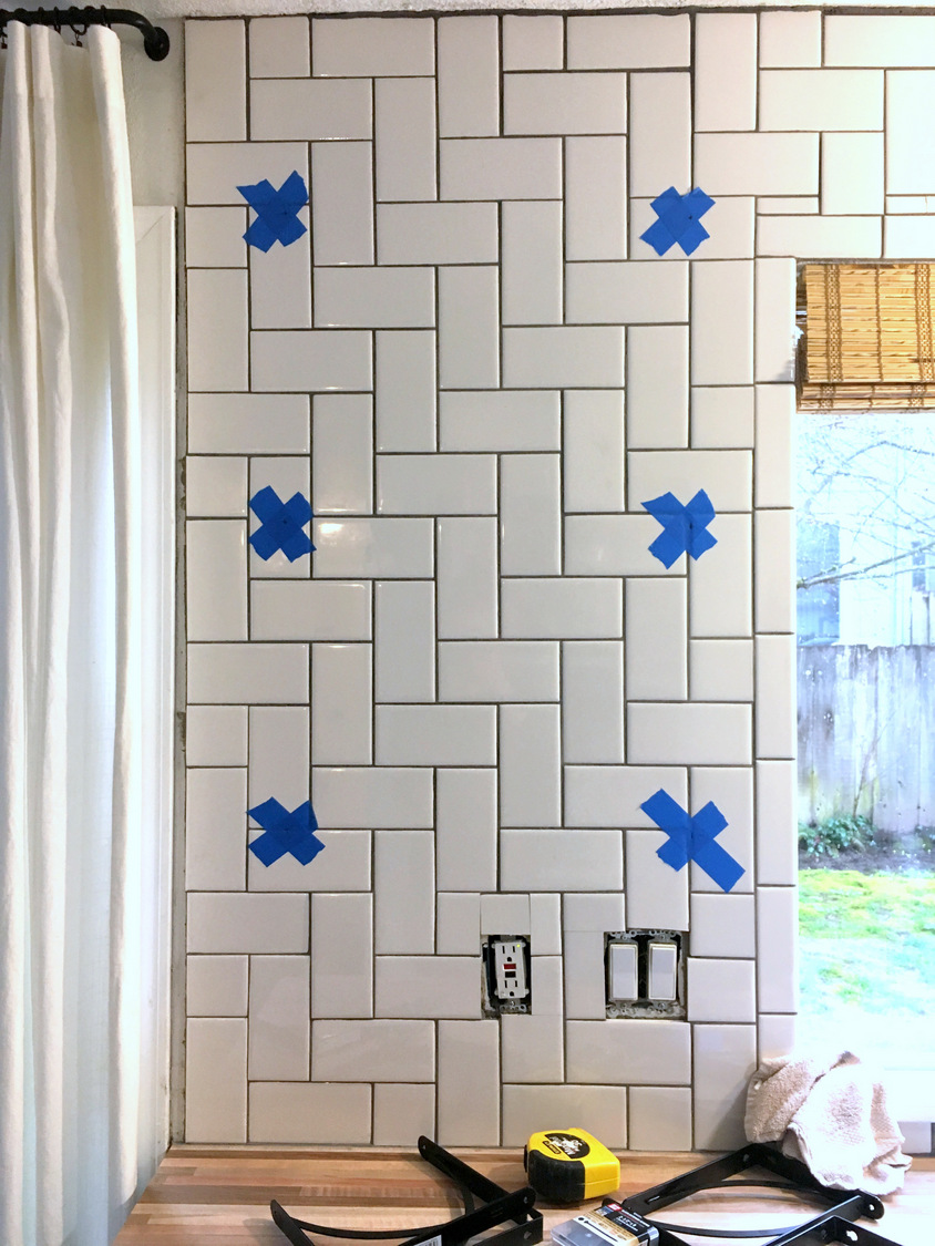drill top bracket holes on one side only to drill through tile start the diamond drill bit at an angle until you make an indentation