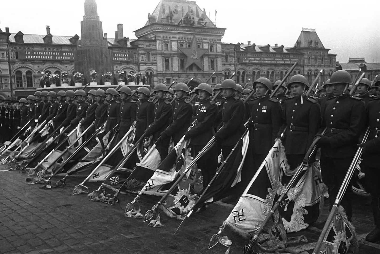 Soviet soldiers with lowered standards of the defeated Nazi forces during the Victory Day parade in Moscow, on June 24, 1945.