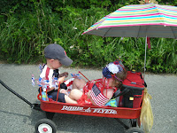kids on wagon on fourth of July