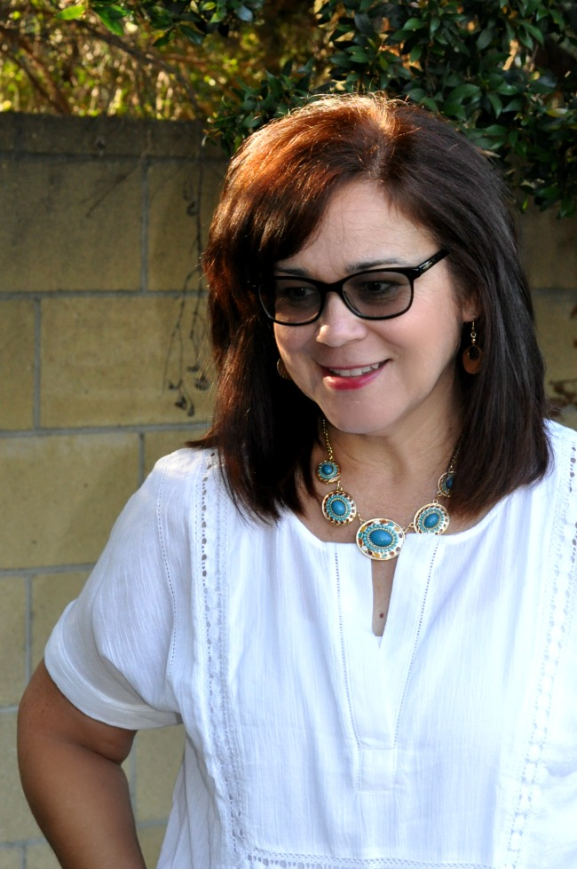 white cotton top and statement necklace