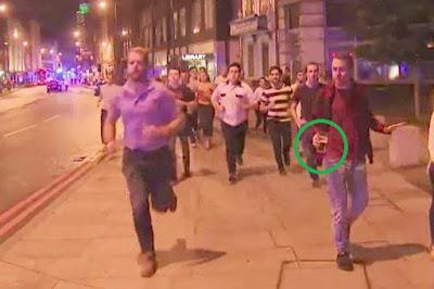 1 - Photo of man 'saving' his pint of beer during London attacks goes viral