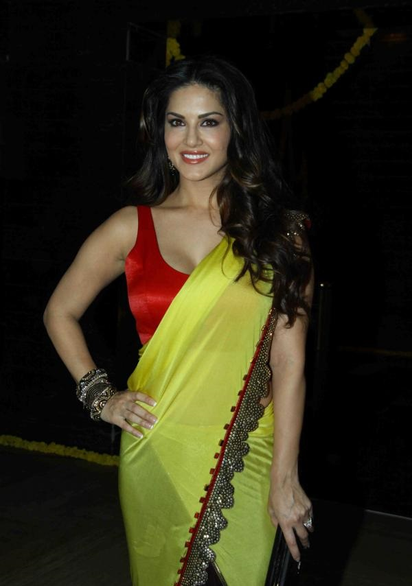 Sunny Leone Long Hair Stills In Hot Yellow Saree