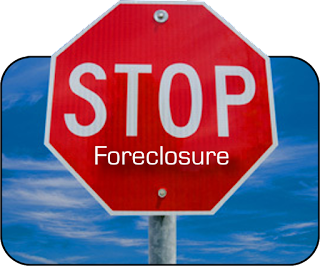 Stop Sign with Foreclosure