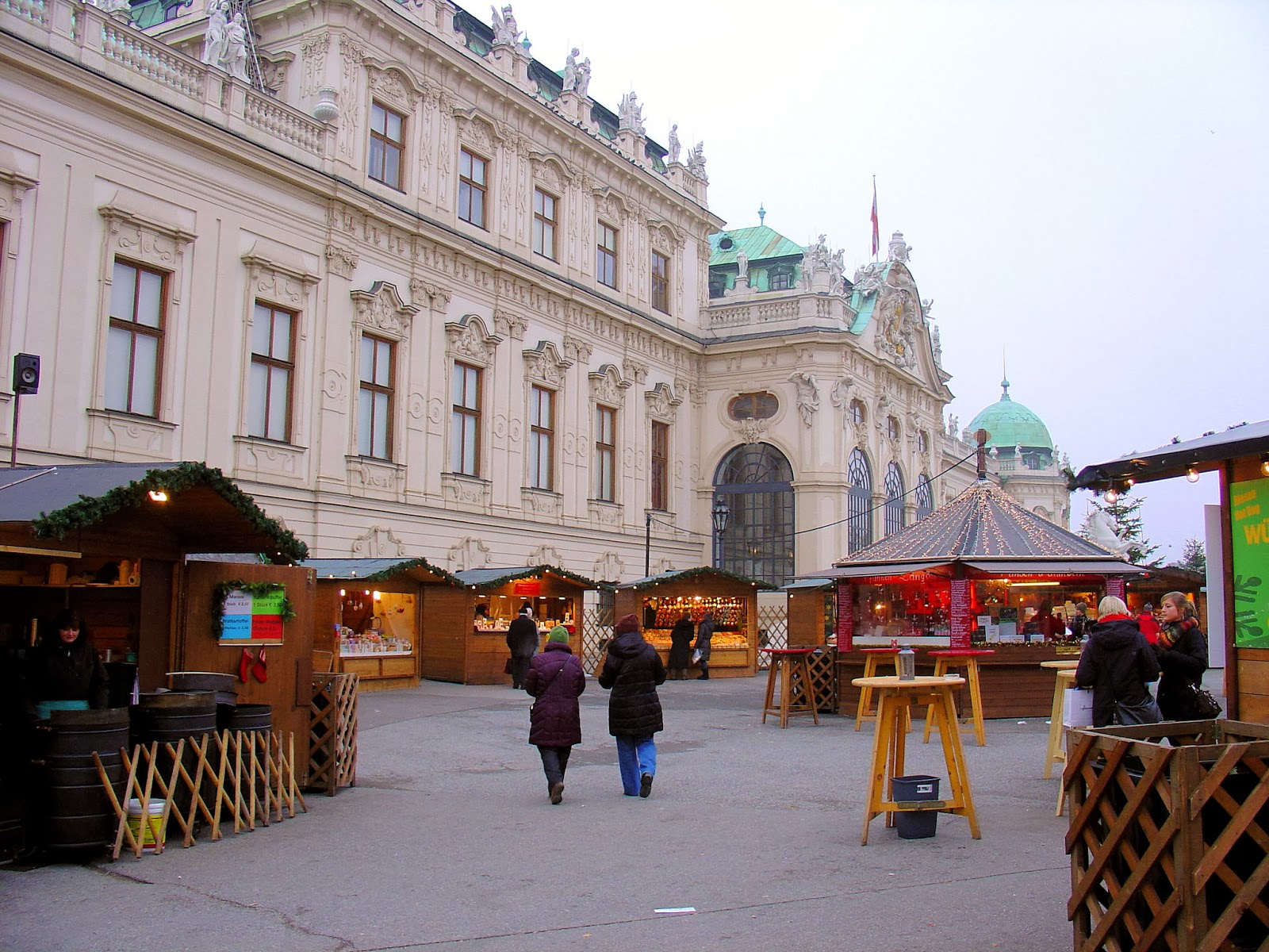 The Belvedere Palace and neighboring Christmas market in Vienna, Austria.