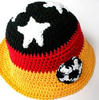 http://www.ravelry.com/patterns/library/soccer-applique-embellishment---fussball-applikation
