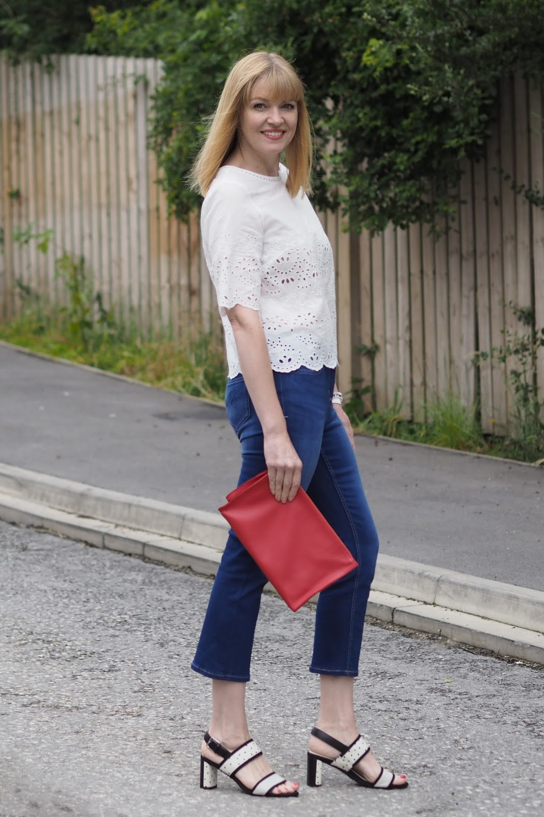 White broderie top, cropped jeans and spotted shoes