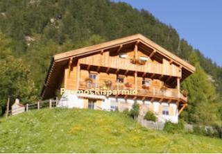 Logo Gallo Rosso: vinci gratis una vacanza in Alto Adige