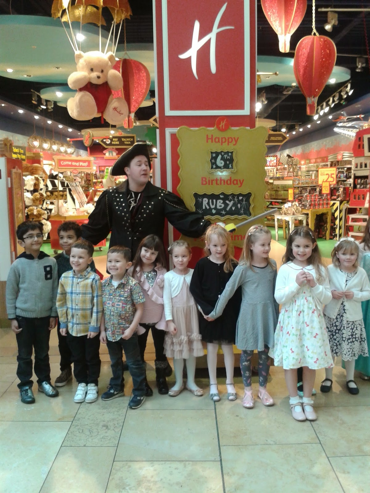 Group of party kids outside Hamleys Toystore Cardiff