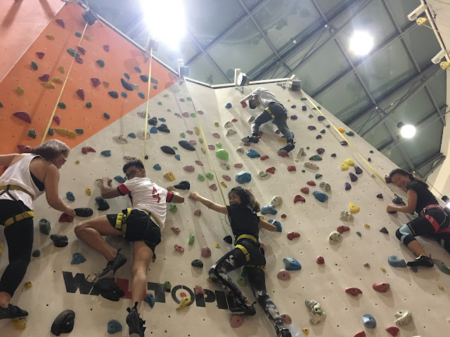 group pic at climb central, auto belay wall
