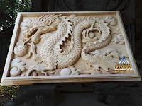 Relief batu alam paras jogja atau batu paras putih gambar naga