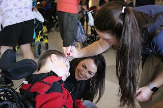 Montgomery Catholic Students Bring Christmas Joy to the Children's Center 1