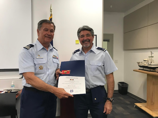 Auxiliarist Bruce Haydu received his Sustained Service Award for 770 hours of service from FC Bill Iwanyk during the May Business Meeting.