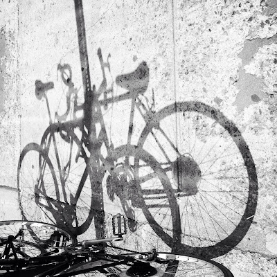 Bicycles / two of them may cast / one shadow. // micropoetry - haiku - haikumages