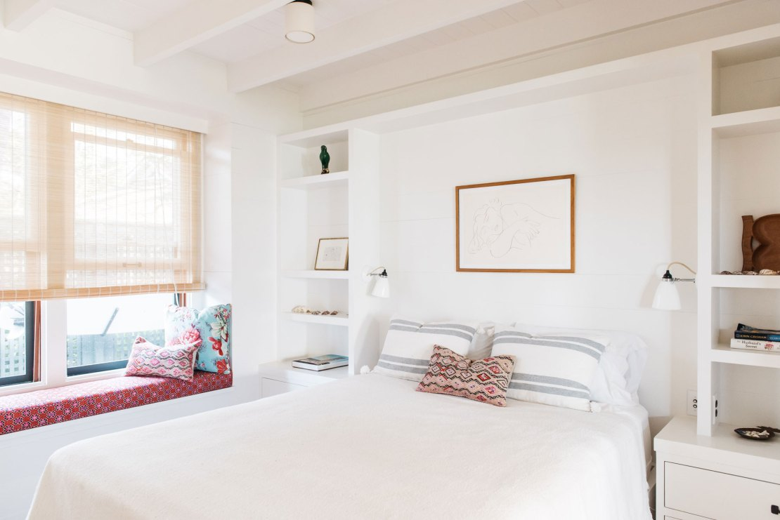 Gorgeous beach cottage bedroom with built-ins flanking bed in Maui - seen on Hello Lovely Studio