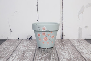 Update any home or garden with this beautiful blossom covered pot decorated using the step by step painting kits from You Can Folk It