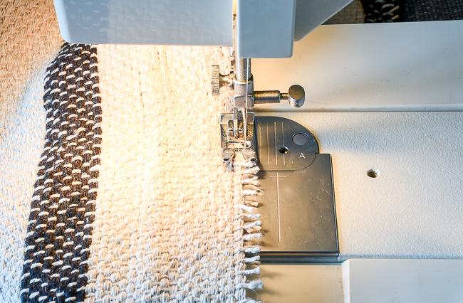 Add zig zag stitch to raw edges on rug