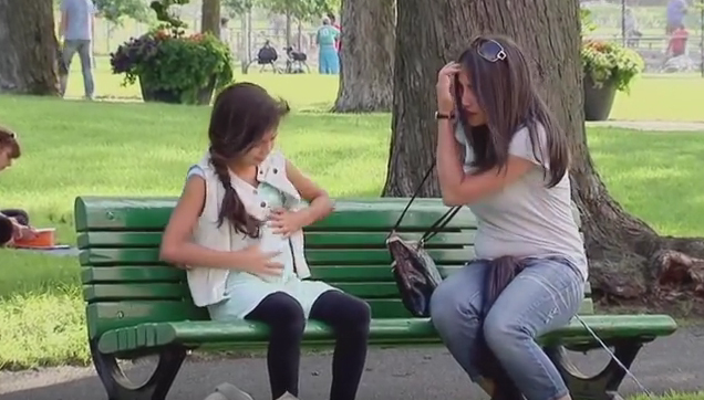 Prank little girl pregnant gets attention from people in the park