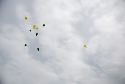 memorial balloon release into the clouds