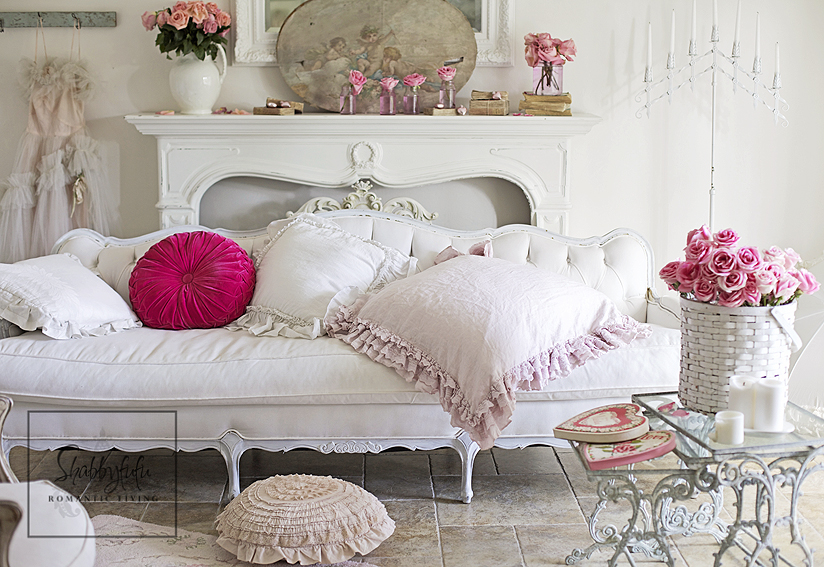 white tufted sofa pink pillows