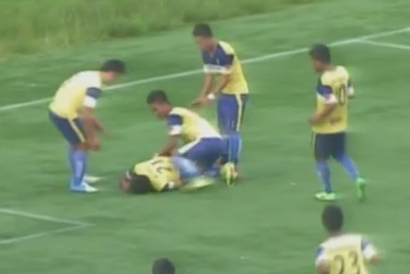 Peter Biaksangzuala is seen lying on the ground after landing awkwardly on his head