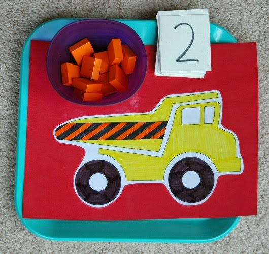 Construction theme math game, adding blocks to dump truck