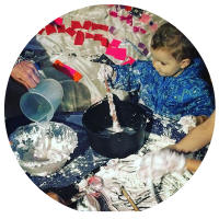 messy play tuff tray with shaving foam, powder paint, water, cornflour