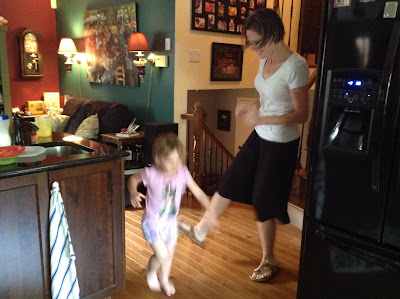 Rae and daughter mid-dance, my house