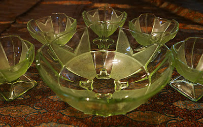 Five small green art deco uranium glass dessert bowls and one large matching serving dish.