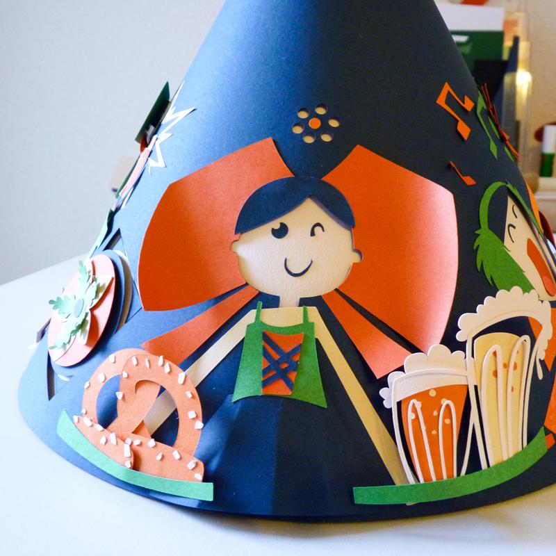 Alsacienne accompagnée de bretzel et bière en papier