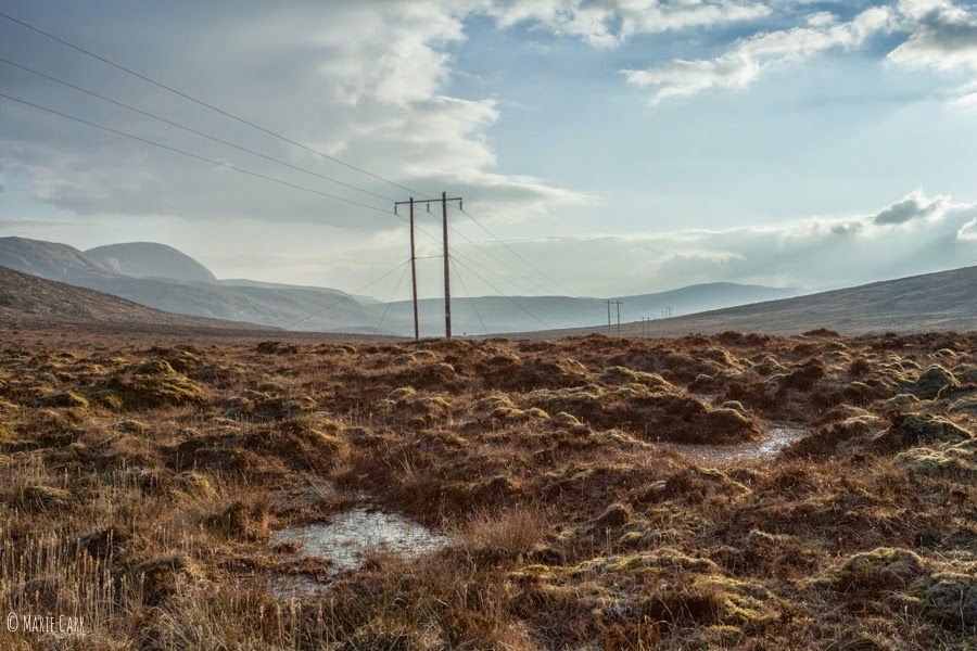 Bog holes and electricity towers on the hills of Donegal, Ireland