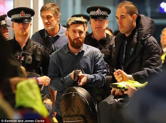 Sad looking Lionel Messi flanked by policemen after Barca's champions league loss (photos)
