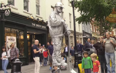 The Silver man shocked passerbys with his floating trick