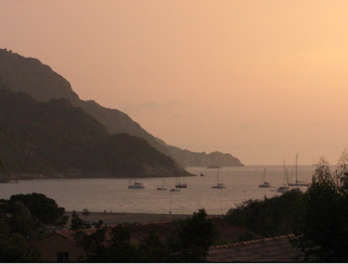 Corsica - Porto at Sunset with boats - Holiday road trip in Europe