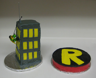 Robin Climbing Building Cake and Robin Logo Cake Together