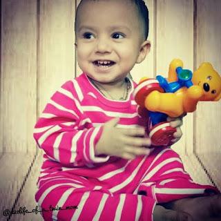 Baby wearing berrytree organic romper