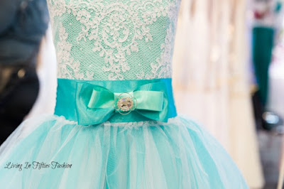 Aqua party dress with full tulle skirt, satin bow, and lace bodice