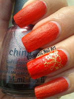 Red liquid sand nail art with golden decals