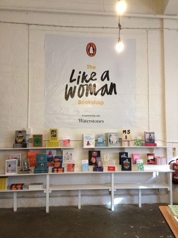Photo of A Like a Woman Bookshop wall display