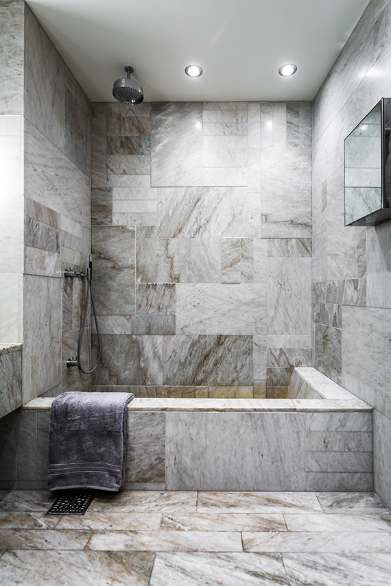 Bathroom With Grey Marble And Built In Tub Via Per Jannson