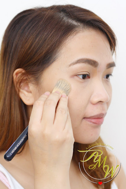 a photo of a girl using Poise Makeup Professional CINEMA TOUCH HD CRÈME Foundation