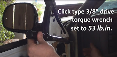 Shows torquing down nuts on 1996 Chevy S10 Blazer side mirror