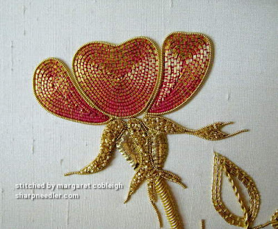 Detail of goldwork rose petals. Petals are couched with red coloured thread.