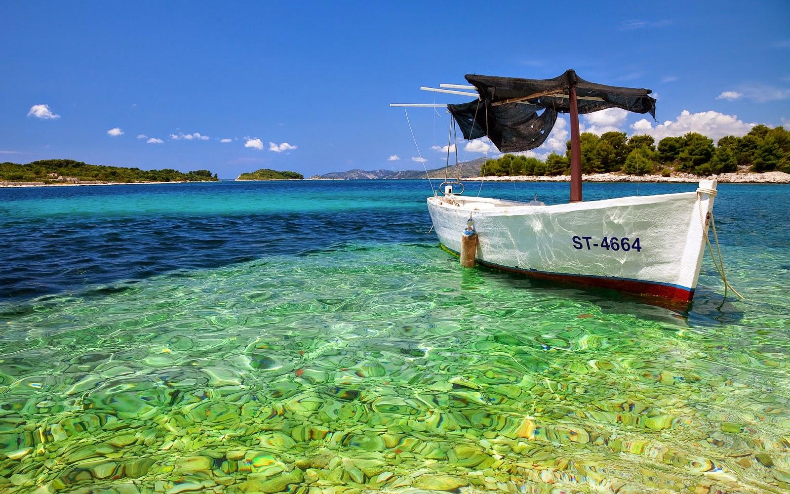 boat in pure water beach hd wallpaper image wallpaper theme