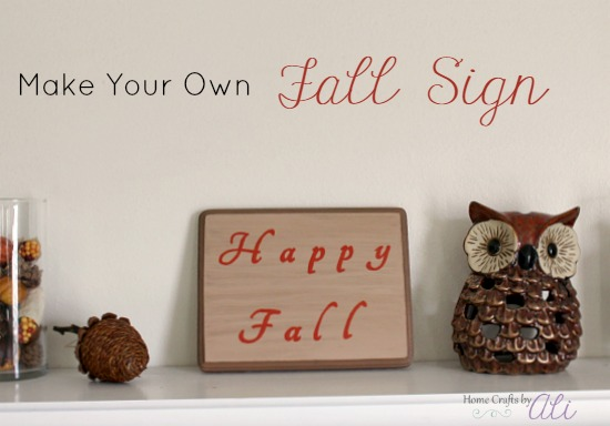 DIY fall sign on display with autumn decor pieces
