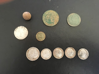 A photo of the hoard of coins that I found with my Minelab Safari metal detector.