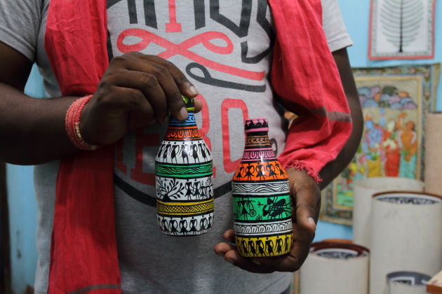Saura Tribal Art portrayed on glass bottles at Raghurajpur, Odisha
