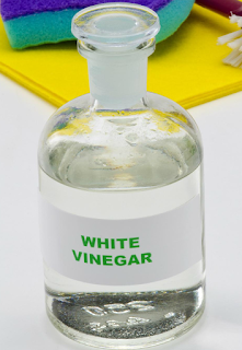 علاج القشرة بالخل الأبيض