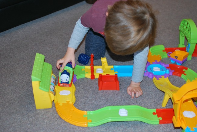 toddler-playing with-fisher-price-my-first-thomas-&-friends-railway-pals