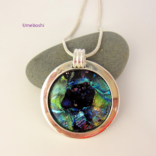 https://umeboshi.indiemade.com/product/blue-nebula-handmade-dichoic-fused-glass-cabochon-jewelry-pendant-blue-green-silver-plated-s