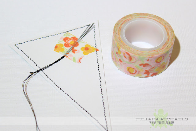 Use washi tape to hold the loose threads when you sew on your scrapbook paper.